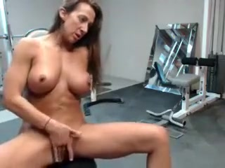 horny milf with nice big boobs playing her pussy in the gym