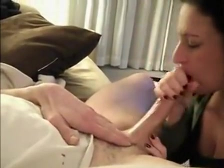 hungry brunette slut cock sucks a stiff cock and horny