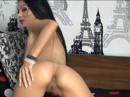 sexy brunette on webcam stripteasing and playing with her big tits