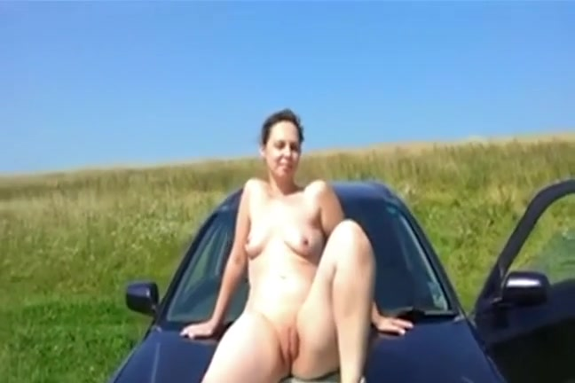 Lascivious Woman Posing On The Car