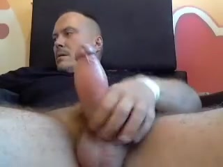 Lovely male is jerking off in a small room and shooting himself on web camera