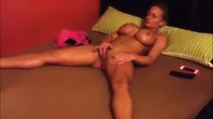 golden haired woman with huge marangos rubs her muff