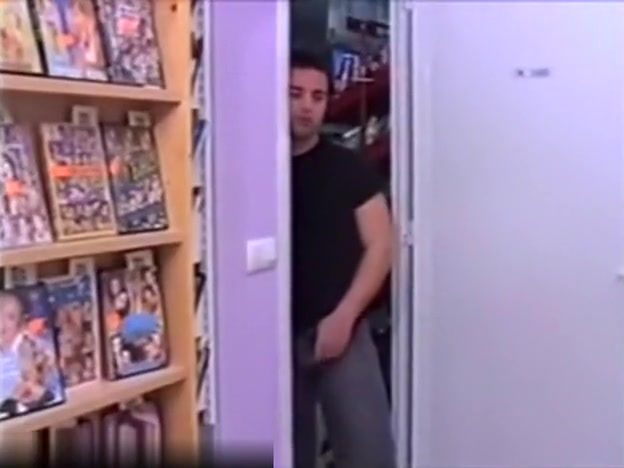 pretty brunette latin milf is having fun with a young guy in a video store
