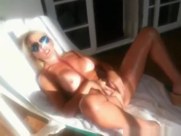 a blonde girl shows off her naked body, masturbates and gets a cumshot in tenerife.