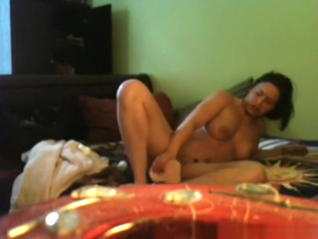 horny brunette fucks herself with 2 dildos