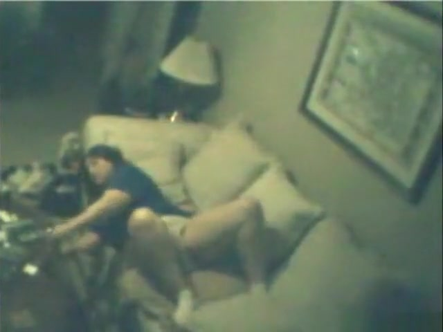 voyeur strips a brunette girl playing with herself on the couch
