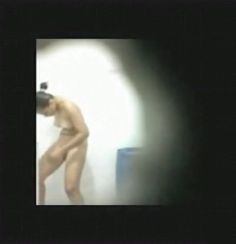 Voyeur tapes an asian girl showering and shaving through a peephole