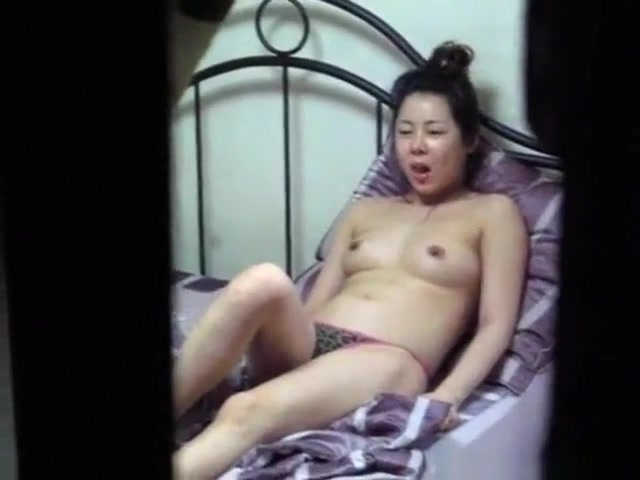 voyeur strips the asian neighbor girl watching tv on her bed with her small breasts uncovered