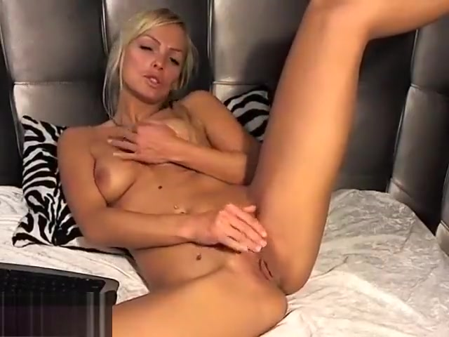 blonde thyhottie strokes her pussy and her tits